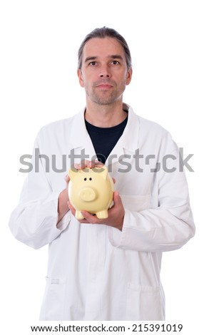 young doctor with piggy bank - stock photo