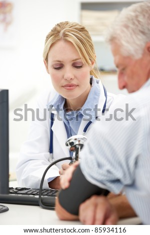 Young doctor with senior patient - stock photo
