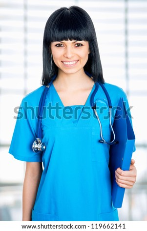 Young doctor with stethoscope and clipboard in an hospital
