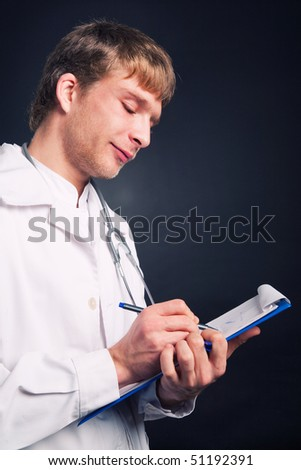 Young doctor with stethoscope writing on clipboard.