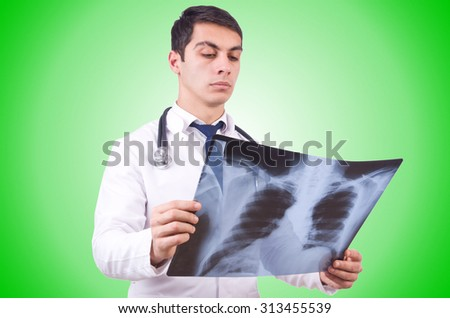 Young doctor with x-ray image on white - stock photo