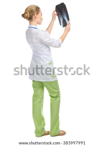 Young doctor with X-ray isolated - stock photo
