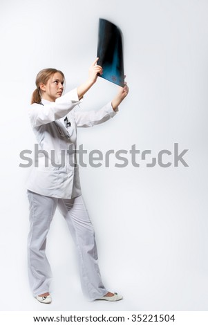 young doctor with x-ray picture isolated over white