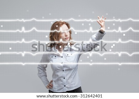 young doctor woman and cardiogram lines in air