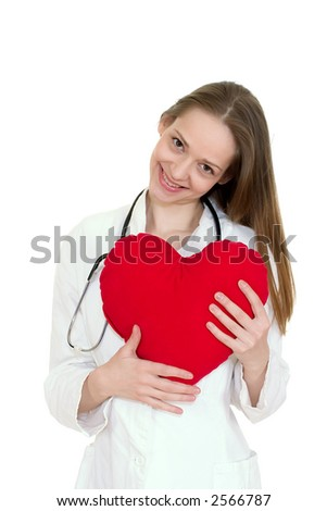 Young doctor women holding a pillow shaped as heart - stock photo