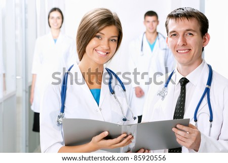 Young doctors looking at camera