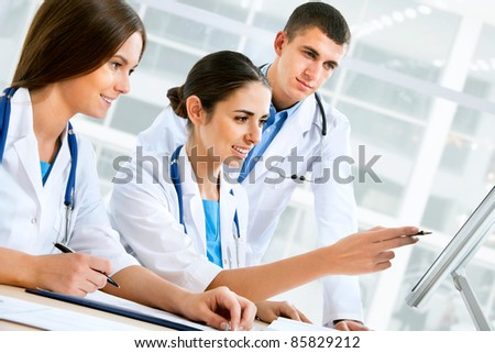Young doctors using computer in hospital
