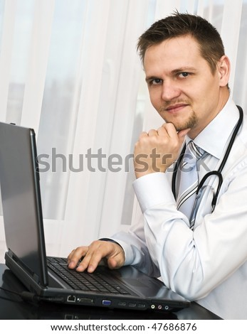 Young doctors working on the computer. - stock photo