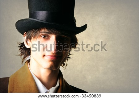 young doorman gentlemen with black hat isolated on white background - stock photo