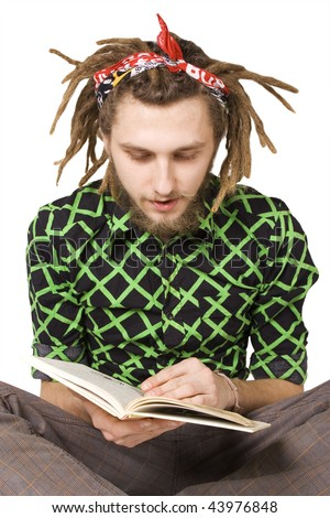 young dreadlock man reading book isolated - stock photo