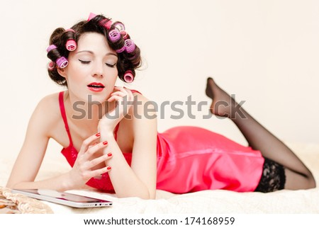 Young dreamy sexy pinup woman wearing pink dress and stockings - stock photo