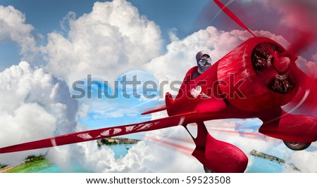 Young dressed up in pilot?s outfit, jacket, hat and glasses playing a plane - stock photo
