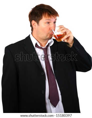 Young drinker - very tired businessman taking a glass of whiskey - stock photo