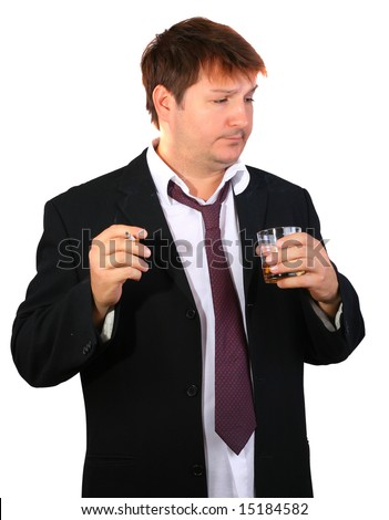 Young drinker - very tired businessman taking a glass of whiskey and smoking a cigarette - stock photo