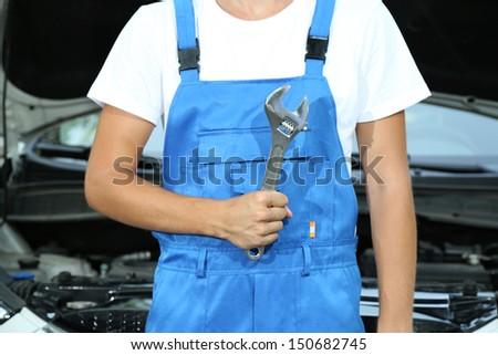 Young driver repairing car - stock photo