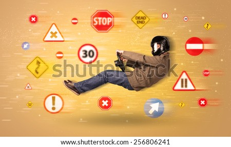 Young driver with road signs around him concept - stock photo