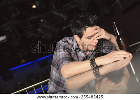 Young drunk man sleeping in the bar - stock photo