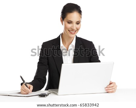 young, dynamic businesswoman working with laptop - stock photo
