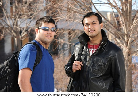 Young eastern Student at the College campus on a sunny day - stock photo