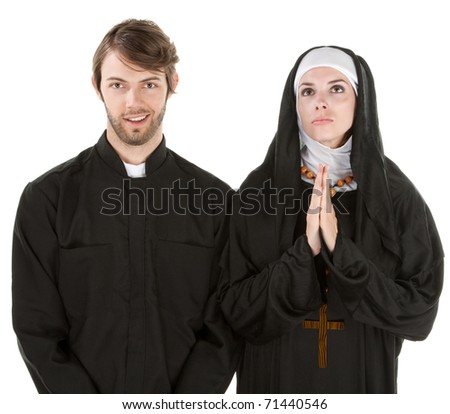 Young easygoing priest with nun praying with white background - stock photo