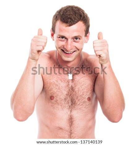 Young ecstatic shirtless man showing thumbs up, isolated on white background - stock photo