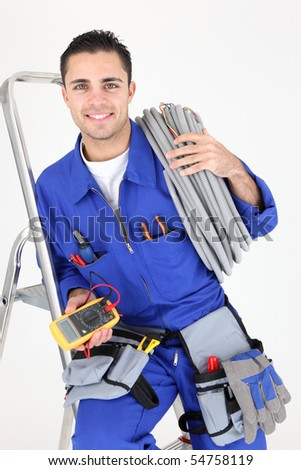 Young electrician leaning on a ladder on white background