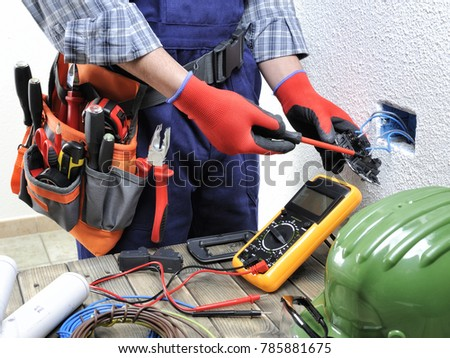 Young Electrician Technician At Work On Switches In A Residential Electrical Installation