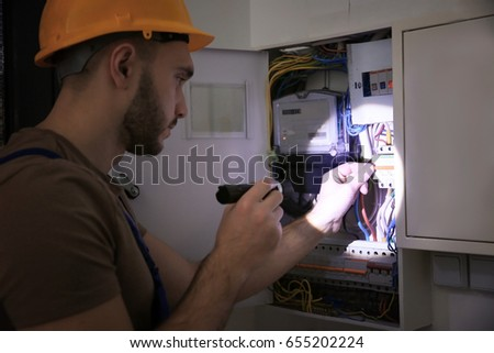 Young Electrician Flashlight Near Switch Box Stockfoto (Lizenzfrei ...