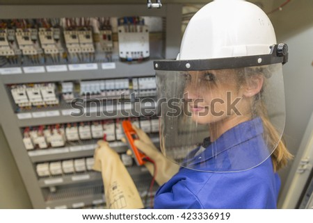 young electrician woman at work - stock photo
