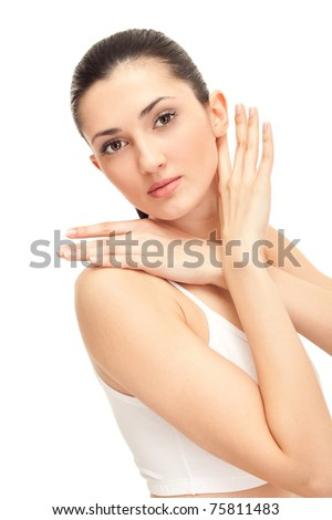 young elegance woman stroking her beautiful face, isolated on white - stock photo