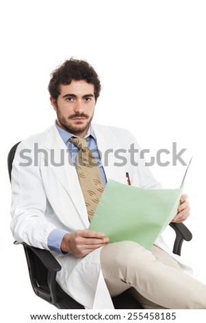 Young elegant doctor with white coat and open folder sit on armchair. Caucasian. Isolated on white.