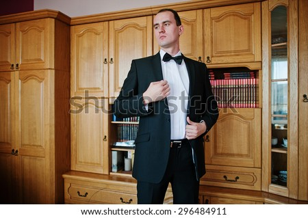 Young elegant groom on his room