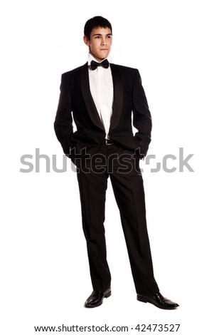 young elegant man in tuxedo, studio shot on white - stock photo