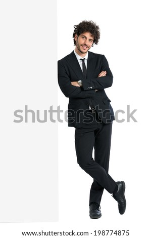Young Elegant Man Leaning On Billboard Isolated On White Background - stock photo