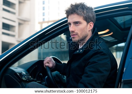 Young elegant man portrait with luxury car.