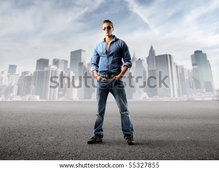 Young elegant man with cityscape on the background