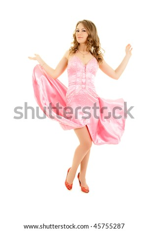 Young elegant smiling woman in pink evening dress
