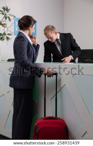 Young elegant woman checking-in at the exclusive hotel - stock photo