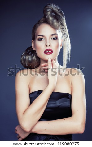 young elegant woman with creative hair style leopard print close up - stock photo