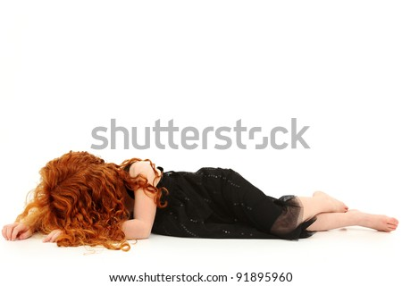 Young elementary girl child laying on floor crying. No face. - stock photo