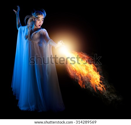 Young elven girl with fire isolated on black - stock photo