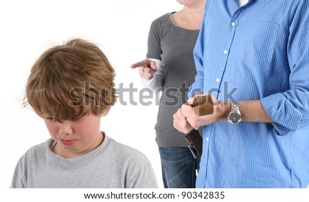 Young Emotional Boy Being Punished by Parents - stock photo