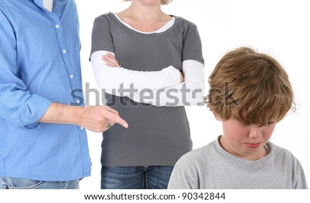 Young Emotional Boy Being Scolded by Parents - stock photo