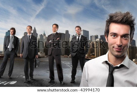 young employee and businessmen on the background - stock photo