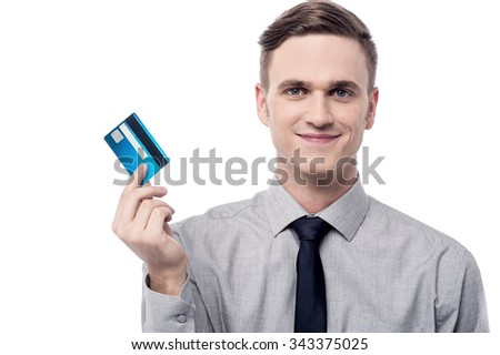 Young employee showing credit card