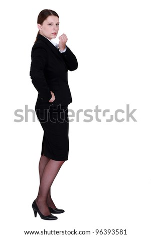 Young employee standing on white background - stock photo