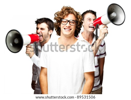 young employees group shouting with megaphones against a white background - stock photo