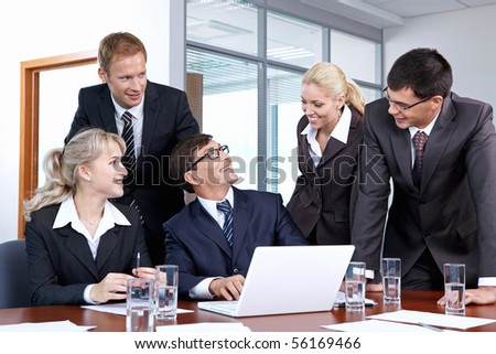 Young employees in an office at the chief - stock photo