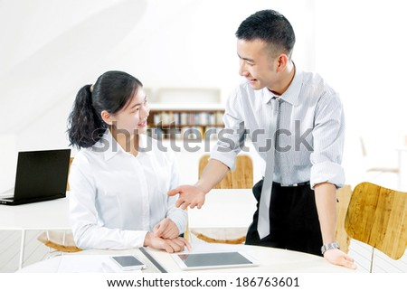 Young employees in the office to discuss - stock photo