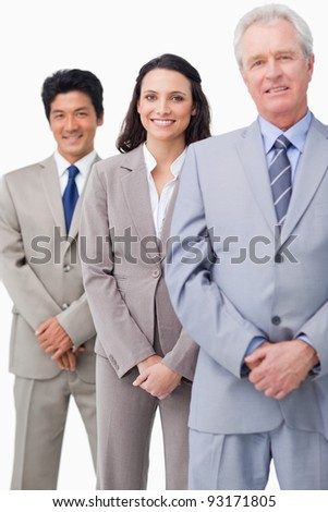 Young employees standing behind their boss against a white background